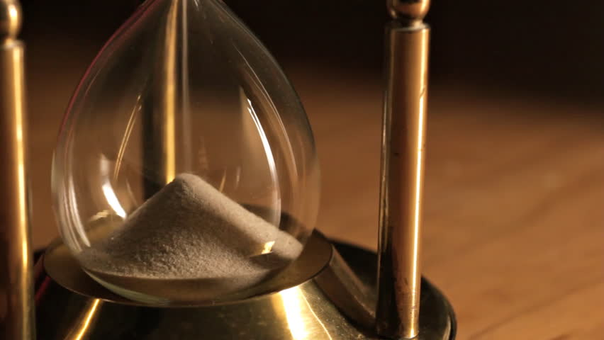 Sand running through old fashioned hourglass #1184431