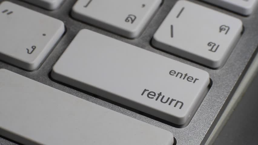 Closeup of finger typing on enter key in a keyboard. #11876879