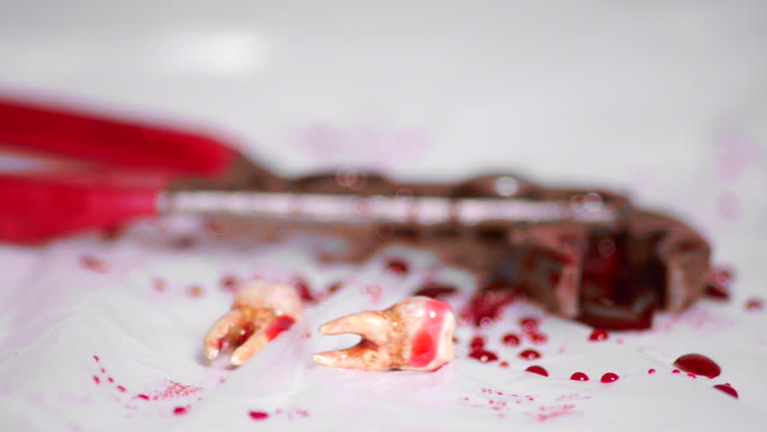 Blood Caked Pliers and Teeth on the Floor   Shutterstock HD Video #11884271