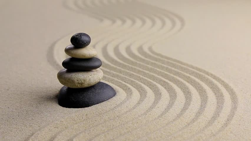 Stones Pyramid On Sand Symbolizing Zen Harmony Balance Motion