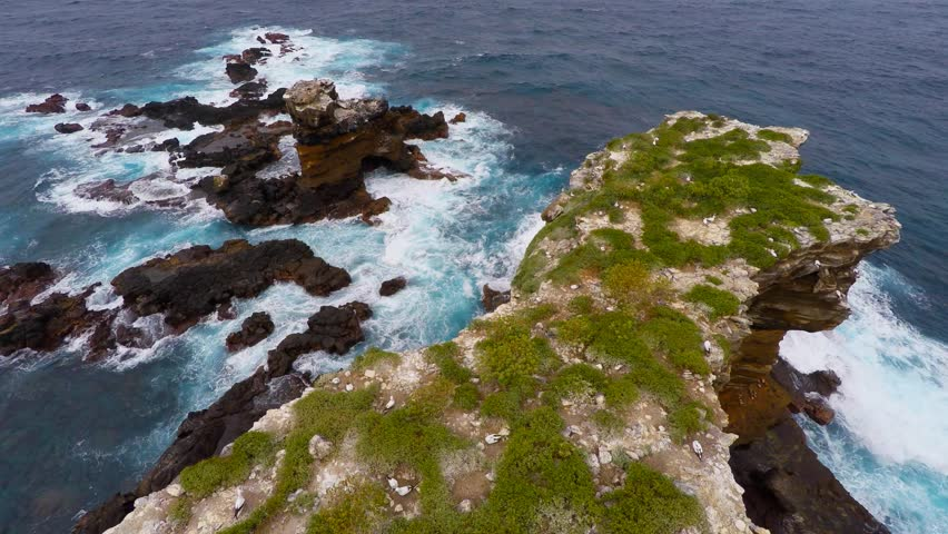 Aerial shot over Darwin Arc an iconic rock  in Galapagos island