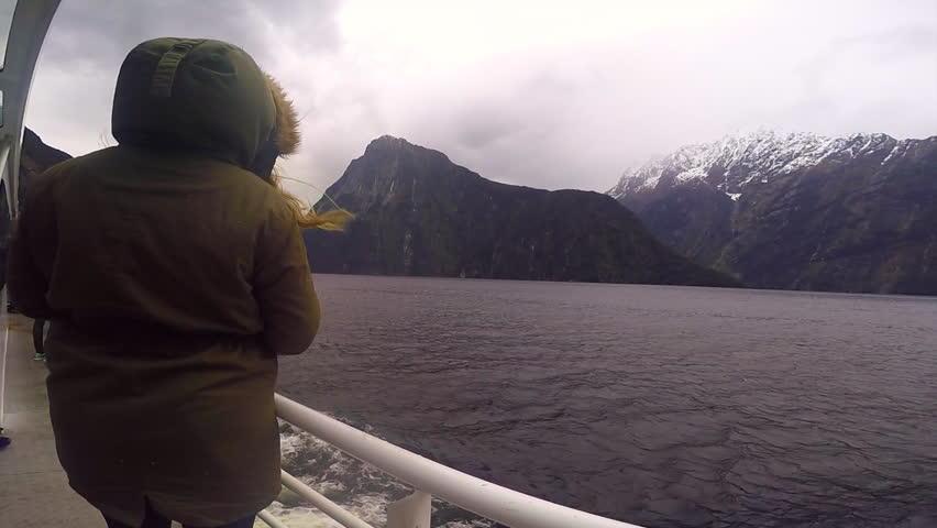 A tourist enjoying the scene on a ferry | Shutterstock HD Video #11904293