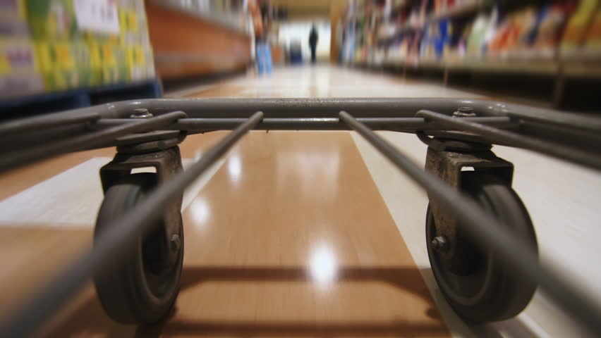 Detail of the Wheels of a Grocery Store Cart Moving inside the Super Market #11916050