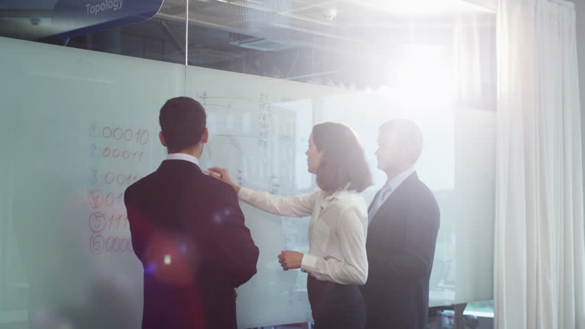Team of Office Workers have Discussion near Glass Whiteboard. Shot on RED Cinema Camera in 4K (UHD). | Shutterstock HD Video #11917751