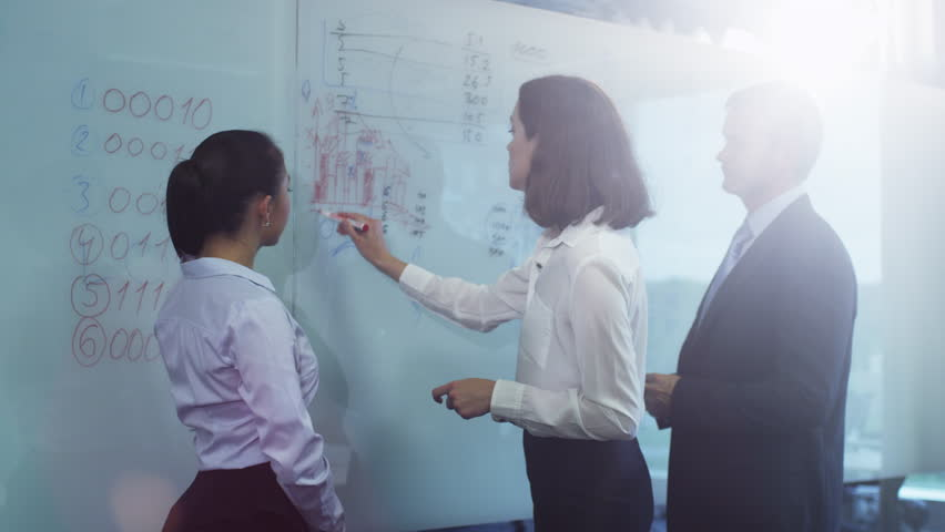 Team of Office Workers have Discussion near Glass Whiteboard. Shot on RED Cinema Camera in 4K (UHD). | Shutterstock HD Video #11917763