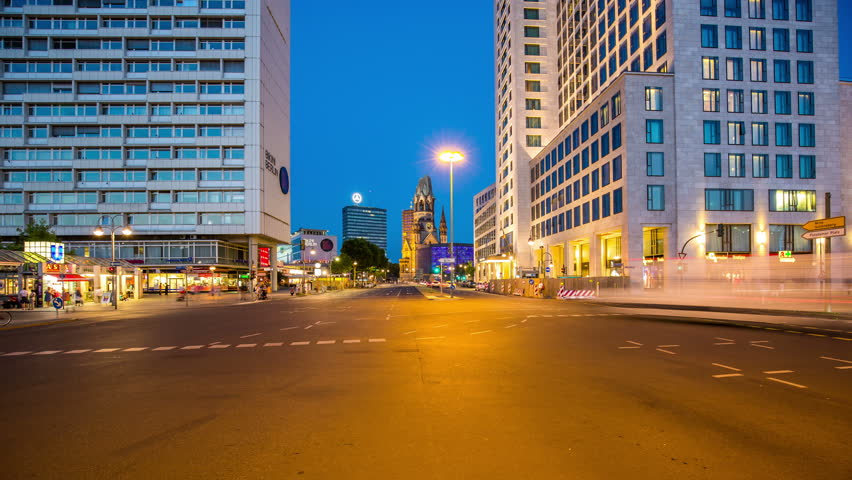 BERLIN, GERMANY – June 16, 2015: kuhfursten damm with crossroad and Church by night timelapse, zoom In Gedachtniskirche, Zologischer Garten, Church, Kuh Damm in the evening with cars | Shutterstock HD Video #11930318