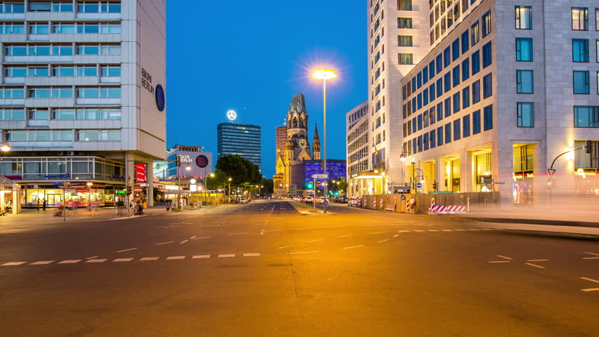 BERLIN, GERMANY – June 16, 2015: kuhfursten damm with crossroad and Church by night timelapse, zoom out Gedachtniskirche, Zologischer Garten, Church, Kuh Damm in the evening with cars | Shutterstock HD Video #11930324