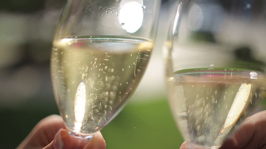 Two Glasses with Champagne in Hands