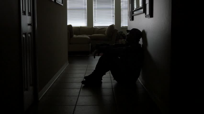 A soldier's sits in a dark hallway while dealing with PTSD, WIDE, 4K | Shutterstock HD Video #11945789