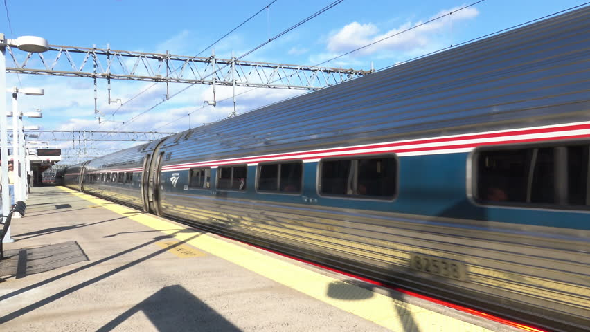 NEW HAVEN, CT - SEPT. 2015: AMTRAK train leaves station. AMTRAK is partially funded by government, but operates as a for profit corporation. The Northeast Corridor route is most traveled.