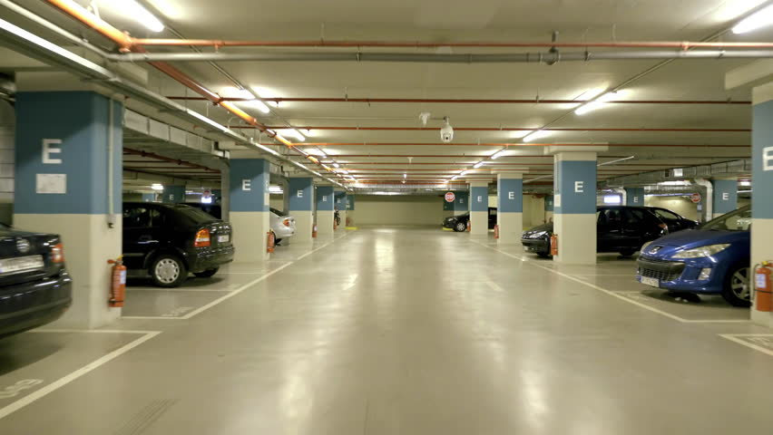 4K Pov drive through underground parking garage,real time.4K Real time vehicle dashboard driving pov through a huge underground parking garage of a big mall/shopping centre.Parking at a free spot. Royalty-Free Stock Footage #11982821