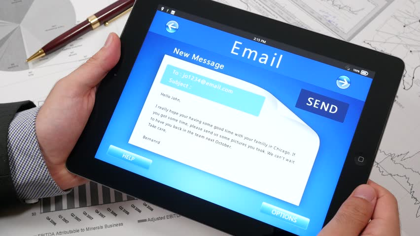 Businessman using a tablet iPad to send email message over the internet