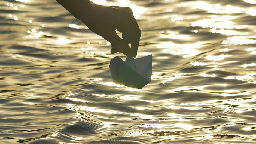 4 in 1 video! The man put paper boat by the bright sunlight reflection on the water surface background. Shot with Red Cinema Camera #11993663