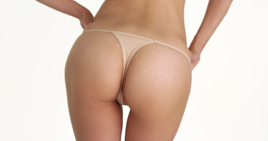 Rear view closeup of woman wearing thong
