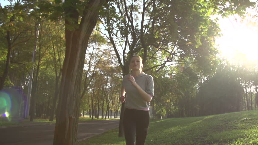 Running in the Park early in the morning, model 25, slo-mo | Shutterstock HD Video #12000887