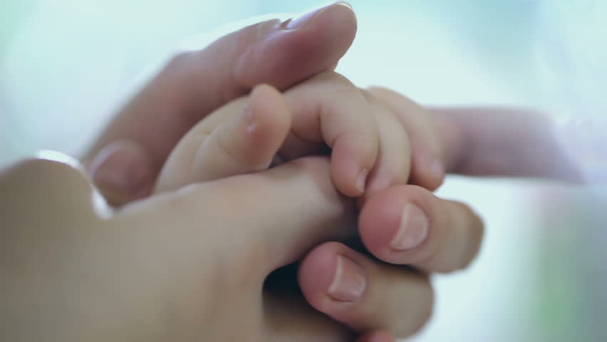 Concept of love and family. hands of mother and baby closeup, Hand in hand. Mother care. Caring mother with baby, Playing with baby. Slow Motion. | Shutterstock HD Video #12004892