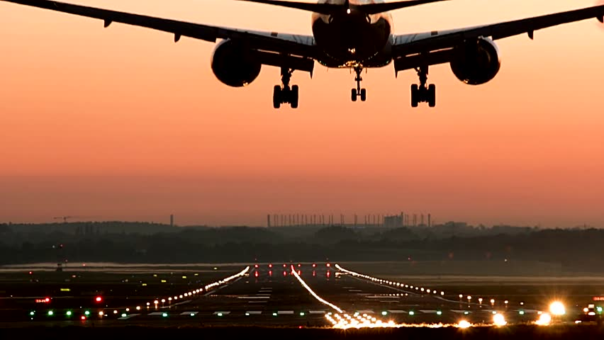 Boeing 777 landing at HAM Airport at sunset