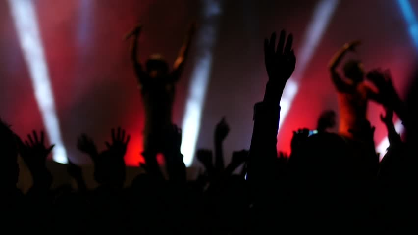 BLAGOEVGRAD, BULGARIA - SEP 26, 2015 - Free public music concert - Cheering crowd fan audience in lumiere light dancing jumping put hands up in air enjoying a music performance | Shutterstock HD Video #12009005