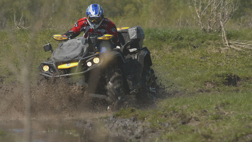 Riding a quad bike in the mud