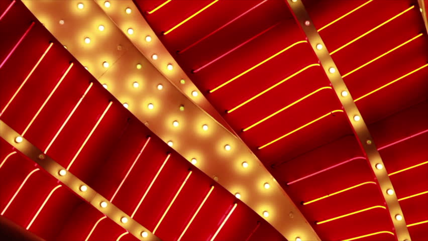 A close up of red and yellow flashing, blinking, rhythmic lights of a large flamboyant sign. | Shutterstock HD Video #1203835