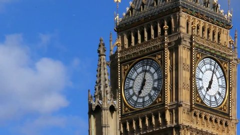 Big Ben in Westminster on blue sky background, London. UK