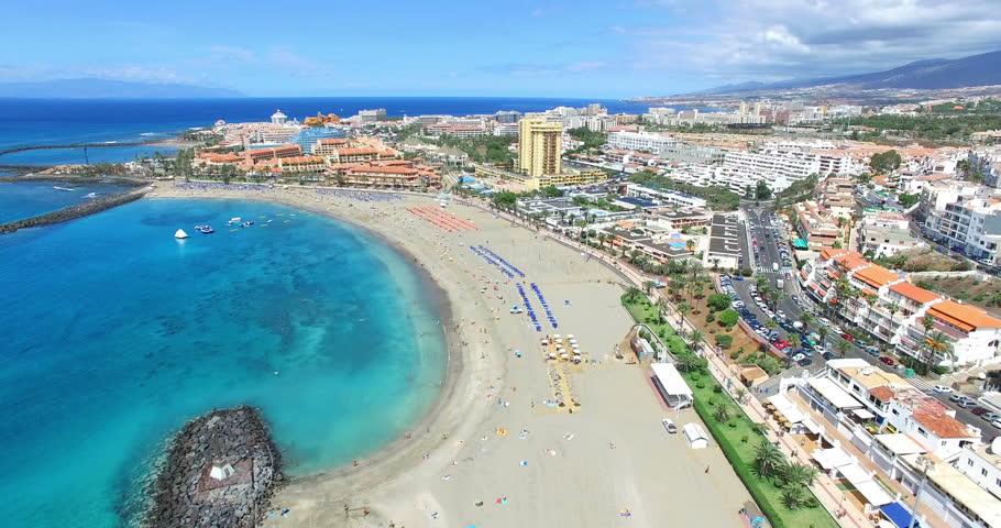 Beautiful aerial flight over Los Cristianos beach (Playa de las America), Canary Island Tenerife, Spain