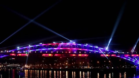 """MOSCOW, RUSSIA - OCTOBER 03, 2015: International Festival """"Circle of Light"""". Laser video show on the bridge in Moscow, Russia"""