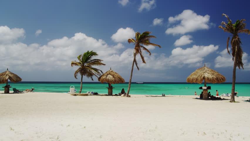 Eagle Beach with Sun seekers and Native Beach Umbrella