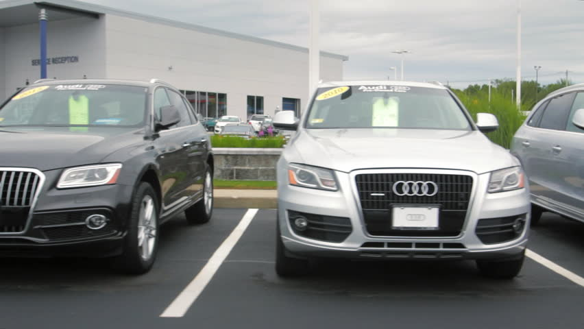 WARWICK, RI - OCT 4, 2015: Cars for sale at Audi auto dealership lot on October 4, 2015. Audi AG is a German automobile manufacturer that designs, engineers, markets, and produces luxury automobiles.