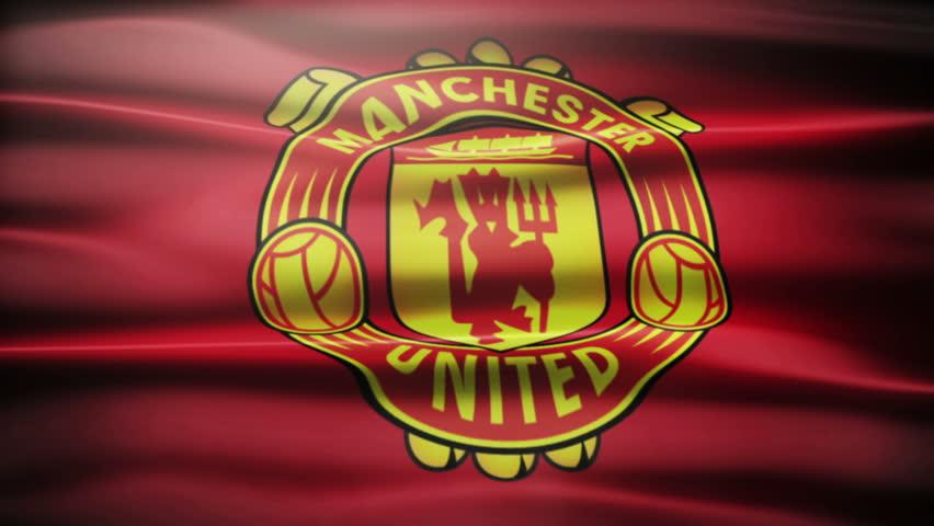 Waving FC Manchester United flag.