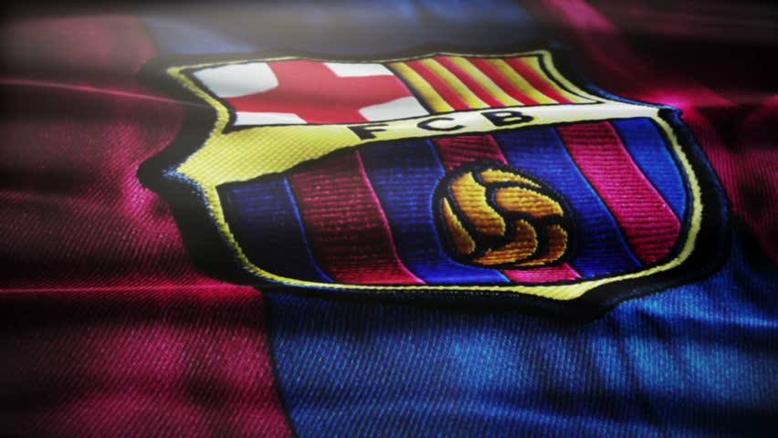Waving FC Barcelona logo..