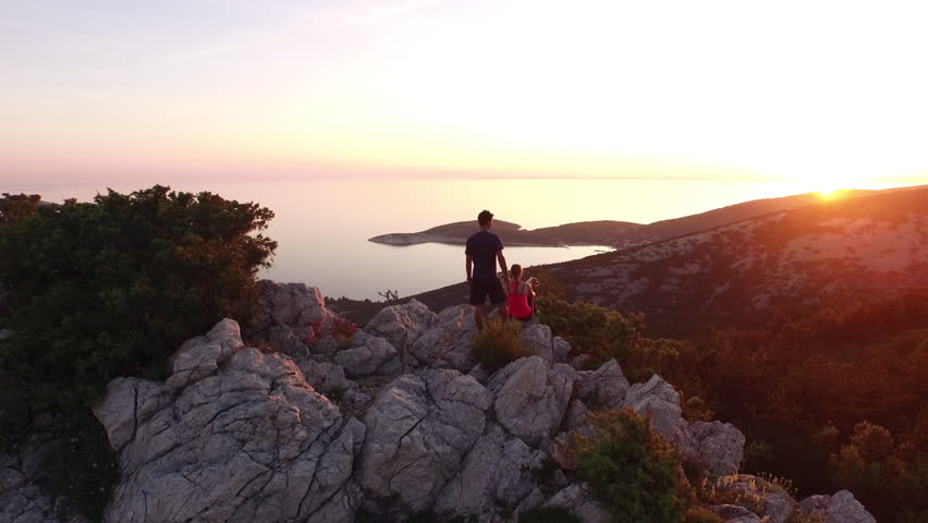 Aerial - Young hikers enjoying the view from seaside mountain peak   Shutterstock HD Video #12090923