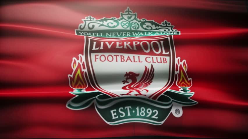 Waving FC Liverpool football flag.