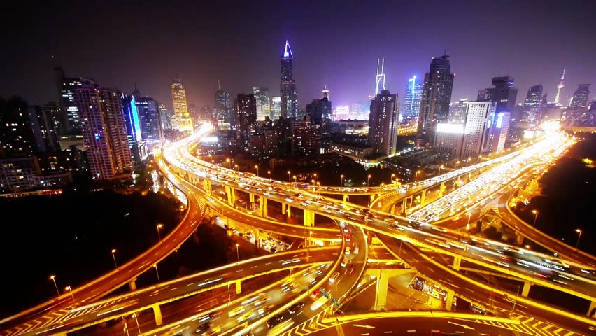 Time lapse,Aerial View of freeway busy city rush hour heavy traffic jam highway,shanghai Yan'an East Road Overpass interchange,driving racing by with streaking lights trail. gh2_07475 | Shutterstock HD Video #12098378