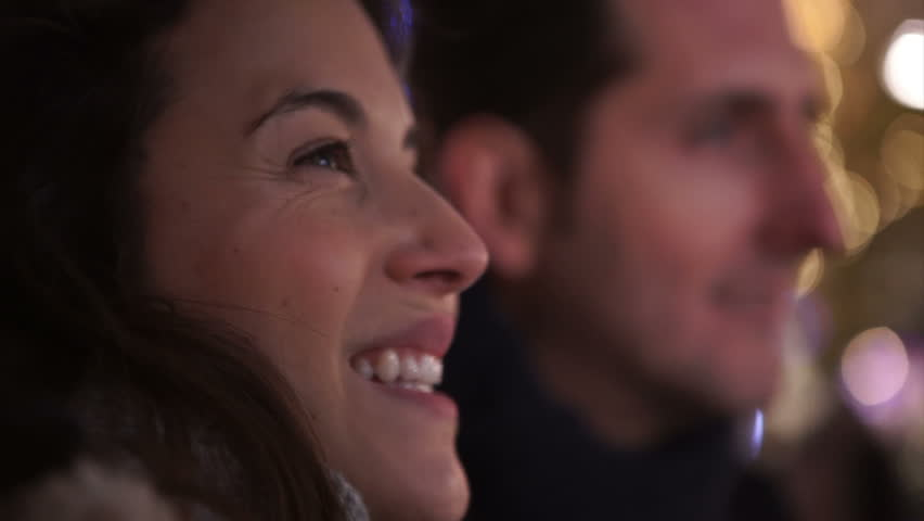 Close up of romantic couple kissing on city street at Christmas time. Shot on RED Epic.   Shutterstock HD Video #12108968