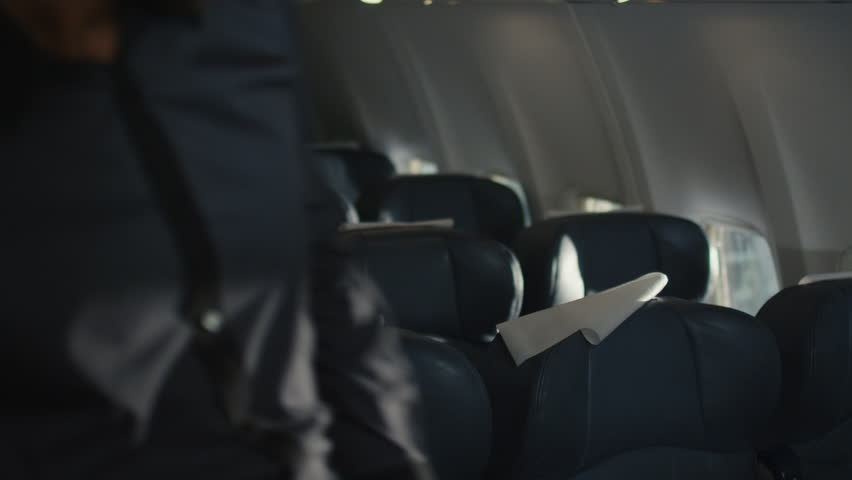 People are entering the cabin of an airplane and sitting down. Shot on RED Cinema Camera in 4K (UHD). | Shutterstock HD Video #12124043