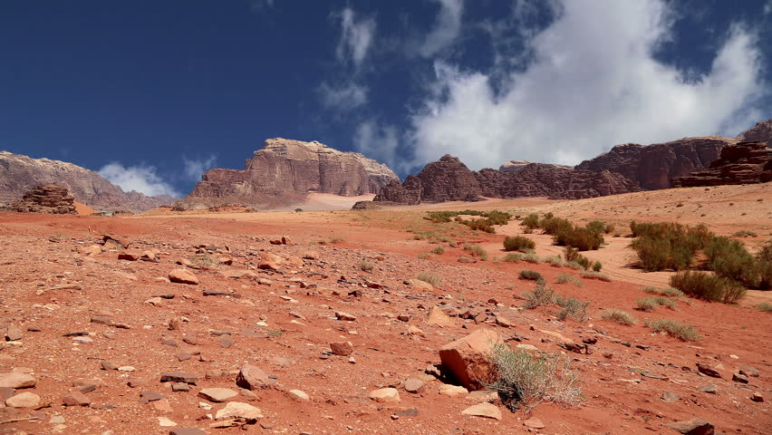 Wadi Rum Desert, Jordan, Middle East-- also known as The Valley of the Moon is a valley cut into the sandstone and granite rock in southern Jordan 60 km to the east of Aqaba   | Shutterstock HD Video #12124151