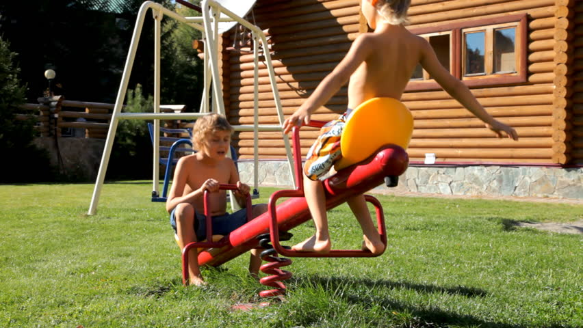 Kids playing on the playground near home | Shutterstock HD Video #12127628