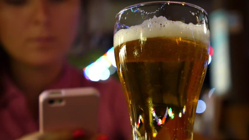 Woman Drinking Beer with Mobile Phone. Closeup. HD, 1920x1080.  | Shutterstock HD Video #12128450