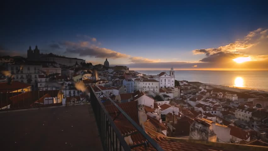 Cinemagraph Loop - Sunset over a coastine town in Lisbon, Portugal - Motion photo #12129224