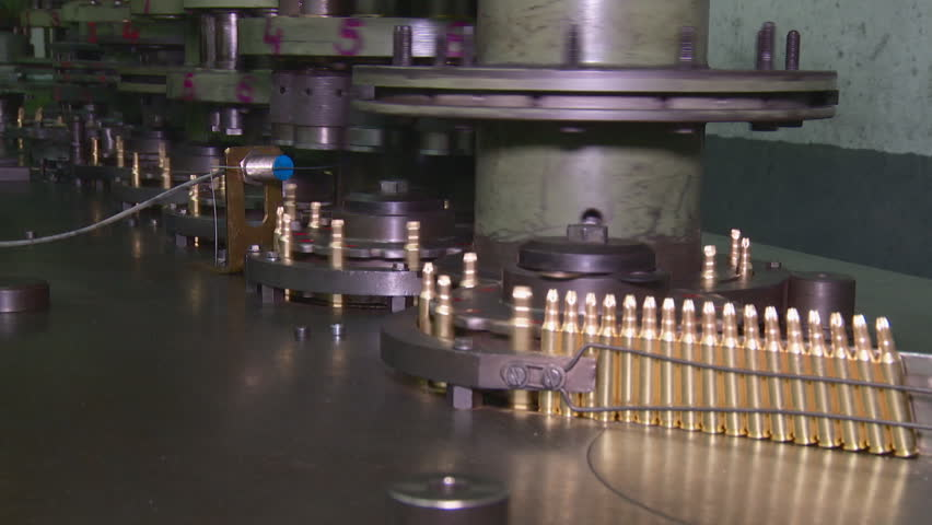 Ammunition factory , bullets for rifle on production line
