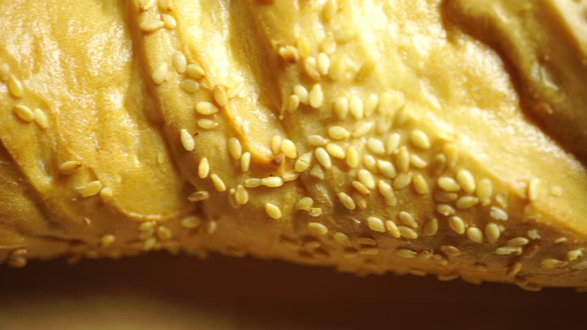 Dolly shot of whole wheat bread covered with sesame #12154985