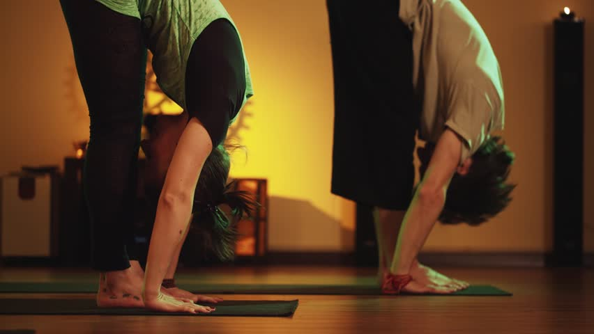 Group yoga Class in a cozy room with candles. Soft and warm subdued lighting #12160514