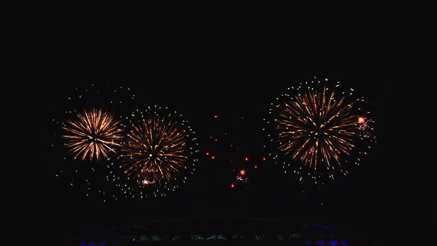 Very Beautiful, amazing colorful exploding fireworks, salut and pyro show in the night sky In The Big City. Loud noises of explosions. Different Colors. | Shutterstock HD Video #12172784