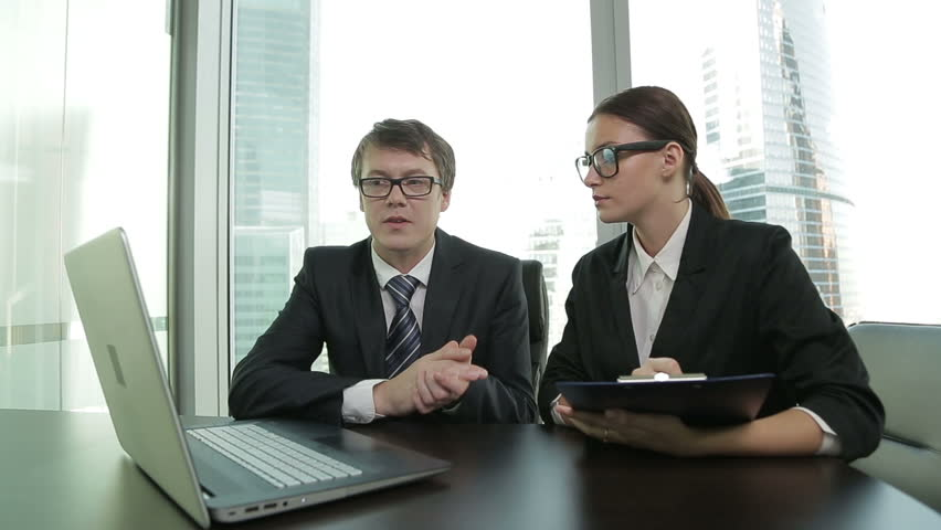 Two business people using laptop in meeting,dolly shot | Shutterstock HD Video #12178625