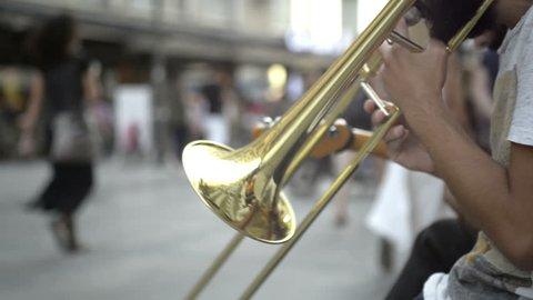 Street Trombonist playing a trombone in the street.