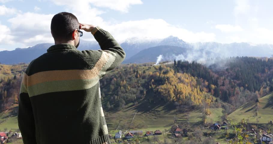 Man admiring the autumn landscape | Shutterstock HD Video #12207923