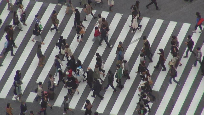 TOKYO - 10 APRIL 2012, Aerial view of commuter cross a busy avenue by day | Shutterstock HD Video #12233084