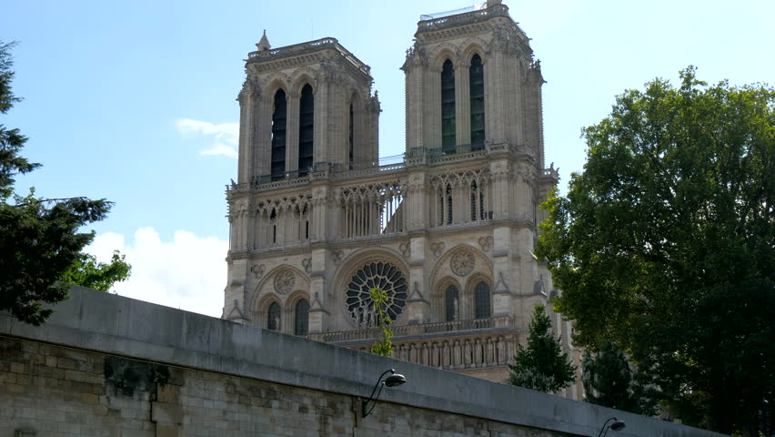 The sneek view of the Notre Dame Cathedral while traveling along the streets of Paris | Shutterstock HD Video #12241427
