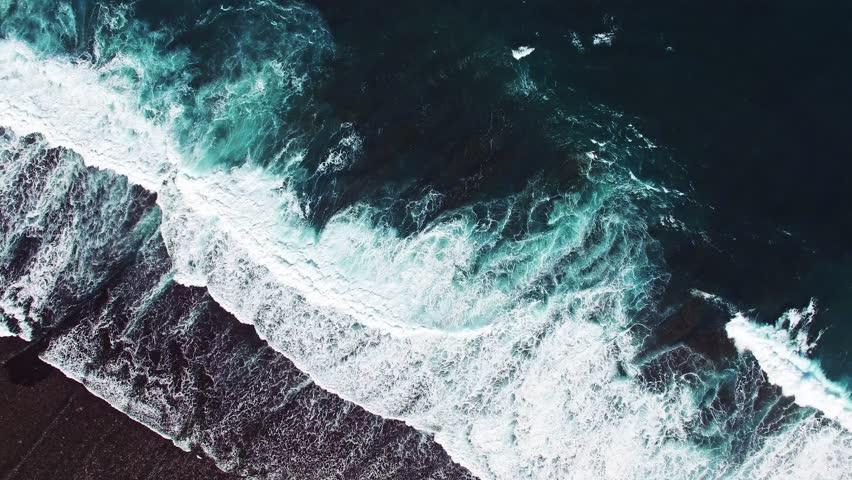 High waves in ocean. Giant Blue Ocean Waves in Indonesia, Bali. Aerial view. Royalty-Free Stock Footage #12250811
